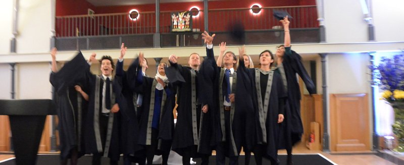 ECBM graduates group hat throw